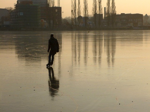 Skating on urban lake.